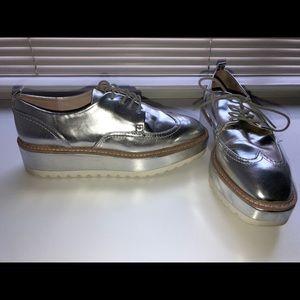 Silver metallic platform shoes